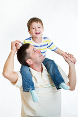 smiling kid boy riding dad's shoulders isolated