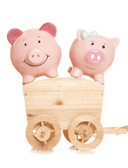 two piggybanks on a wooden cart