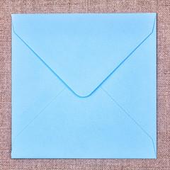 Blue envelope on  fabric background