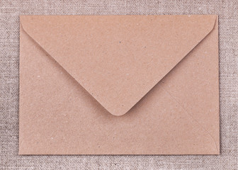 Brown envelope on  fabric background