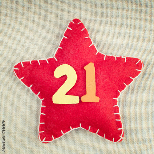 Poster Red star with wooden number 21 on vintage fabric background