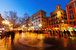 Постер, плакат: Pavement mosaic by Joan Miro on la Rambla in evening