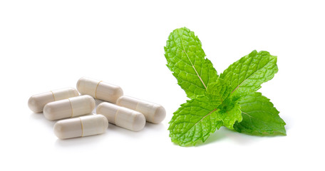 pill and mint isolated on white background