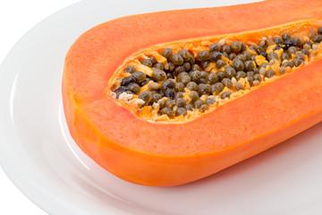 Half of papaya isolated on white background