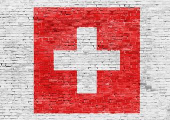 Flag of Switzerland over brick wall