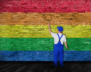 House painter covers wall with rainbow flag