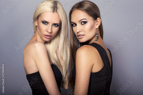canvas print picture two beautiful sexy girls with luxurious hair and bright makeup