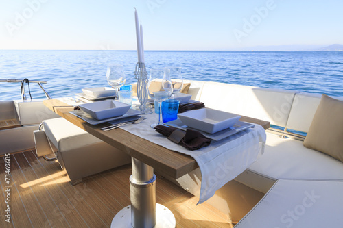 lunch on motor yacht, Table setting at a luxury yacht. - 73469685