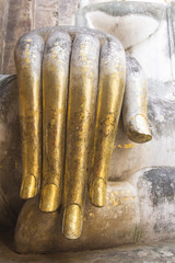 Hand of Buddha statue covered with gold sheet