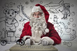 Technological Santa Claus ordering toys for kids