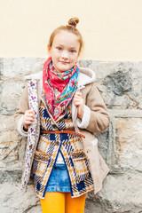 Fashion portrait of a cute little girl