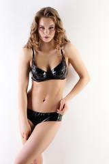 Sensual blonde posing in black latex lingerie