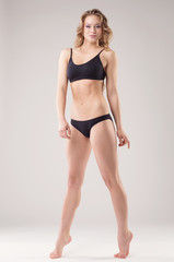 Graceful young woman posing on tiptoe