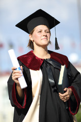 young woman graduate with a diploma