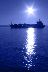 silhouette tanker on a background of the night star