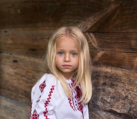 Wonderful little blonde girl in ukrainian national costume