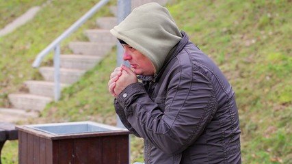 Man cold at outdoors on the bench
