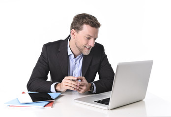 businessman working happy at computer smiling relaxed
