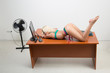canvas print picture - girl in lingerie on the office desk