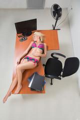 girl in lingerie on the office desk