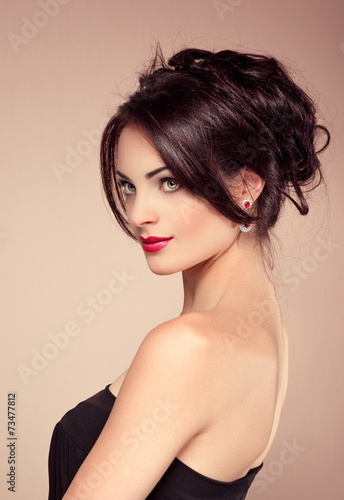 Fototapeta Beauty portrait of young girl with evening curly hairstyle