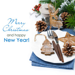 Christmas table setting with wooden decorations over white