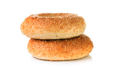 Two Bagels with sesame seeds on white