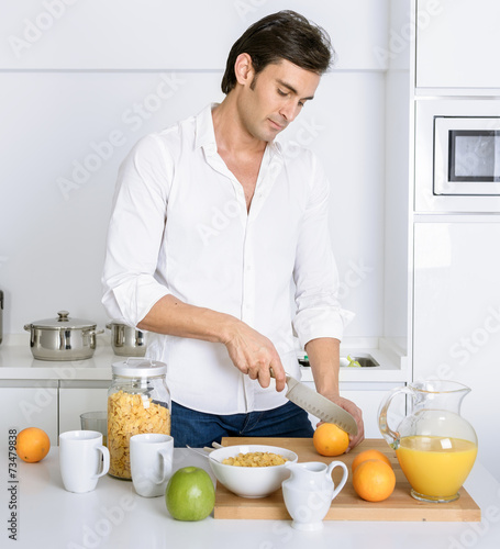 canvas print picture Man preparing breakfast