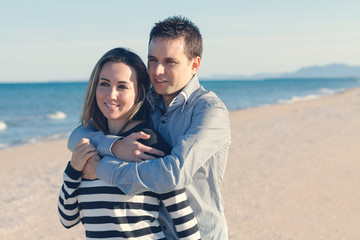 Couple in love with beach background