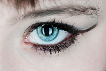 Woman with blue eye staring at you
