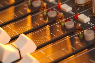 soundboard fader illuminated by stage lighting