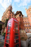 Red telephone box with Kings Cross Station, London