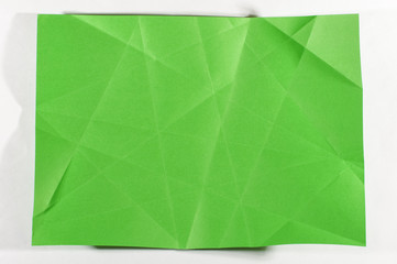Unfolded green sheet of A4 paper