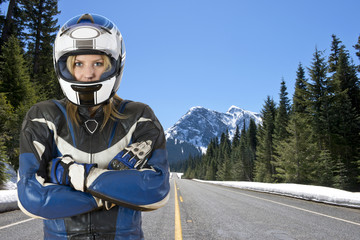 Motorcyclist on mountain road