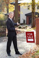 Smiling estate agent
