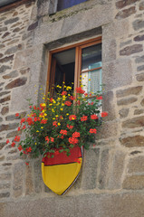Medieval building with flowers.