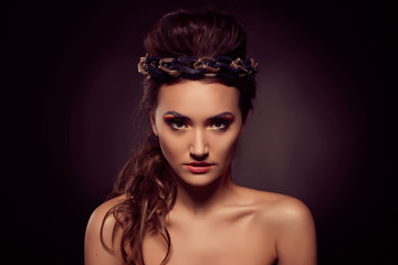 Fashion portrait of brown-eyes  woman. Gold tiara. Orange yellow