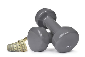 Fitness dumbbells with measuring tape isolated on white