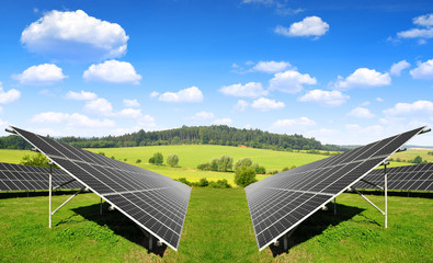 Solar energy panels in spring landscape