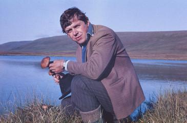 Soviet gold-prospector mushrooming in tundra in July 1983.