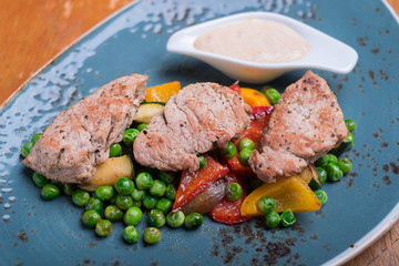 Roasted pork meat fillet chops with zucchin