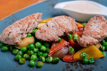 Roasted pork meat fillet chops with zucchini