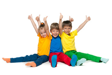 Cheerful children hold their thumbs up