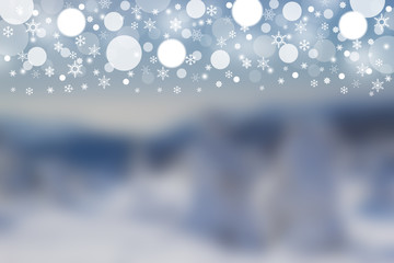 Blurred winter background with balls and snowflakes