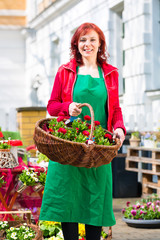 Florist delivering basket of flowers or viola