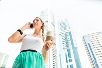 Young woman using mobile phone in Dubai