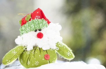 Christmas decoration with Santa Claus figurine in the snow