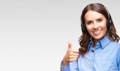 Support phone operator with thumb up gesture, on grey