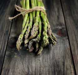 Bunch of fresh asparagus on a black background