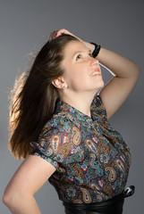 Beautiful  brunette woman looking up